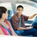 Couple in vehicle wearing seat belts