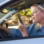Woman driving and on cell phone