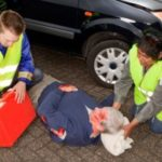 First responders attending to car accident victim